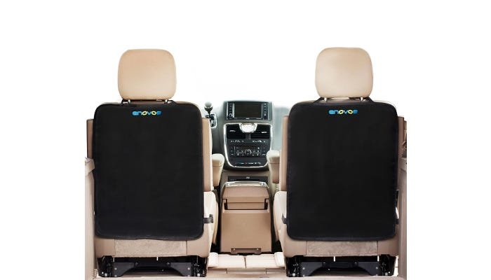 Two black seat back covers are visible from the perspective of the interior of the backseat of a car.
