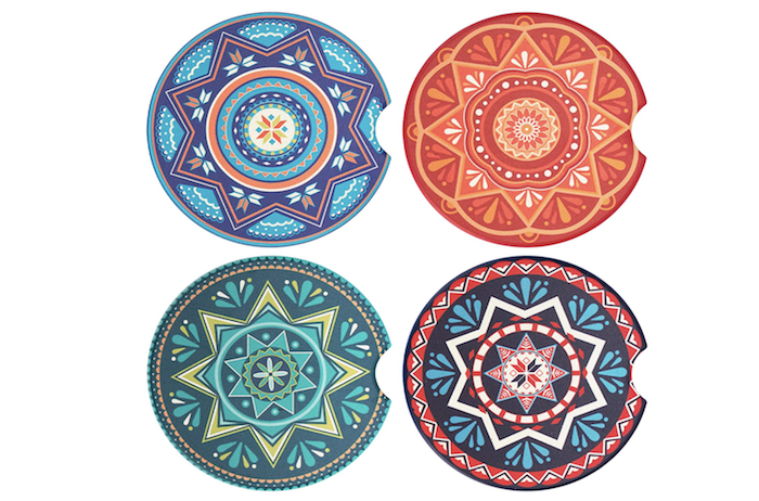 a set of four multicolored car cup holder coasters with mandala designs