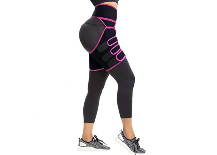 A woman wearing a black and pink waist trainer that also extends down to her thighs over her leggings