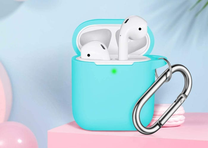 Mint green AirPods case attached to Apple AirPods case, showing green charging light