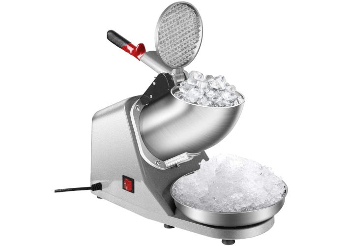 Heavy-duty stainless steel snow cone machine with whole ice cubes in the intake tube and shaved ice on the tray.