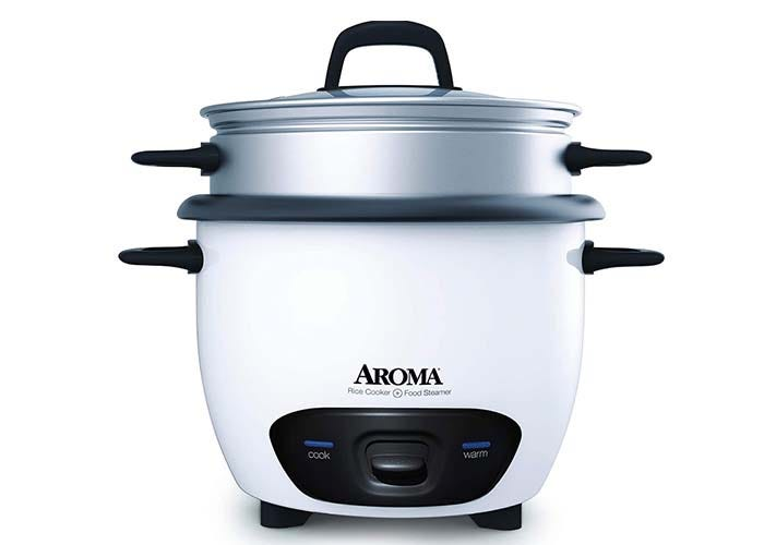 a white rice cooker with a stainless steel insert and lid
