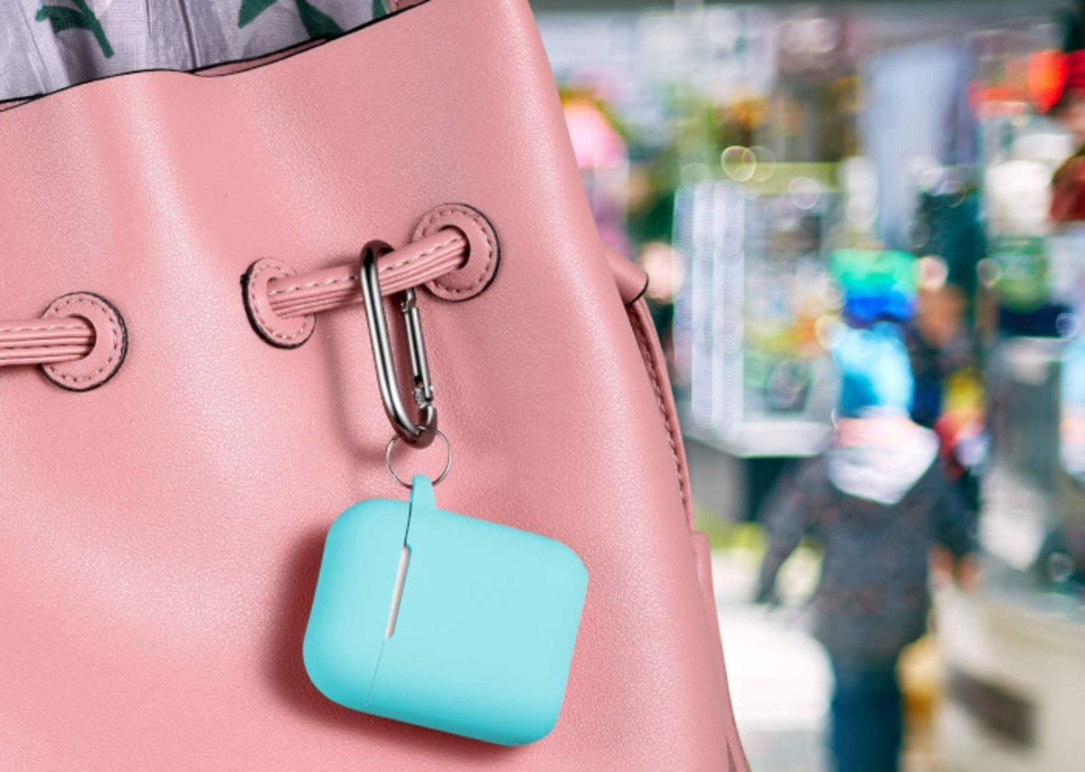Sky blue AirPods case attached to handbag by a metal carabiner