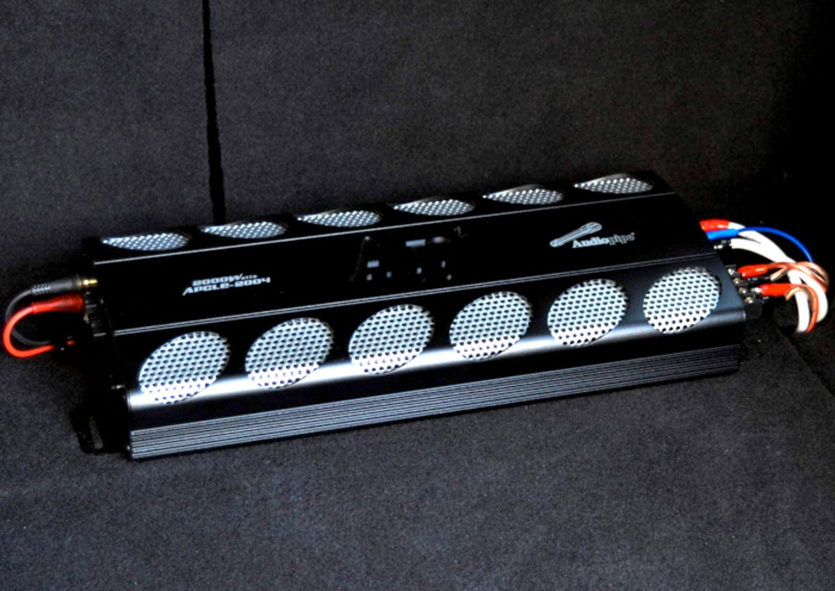4 Channel amp in a vehicles trunk with wiring hooked up on both sides