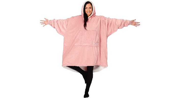 a woman wearing a pink Sherpa blanket hoodie