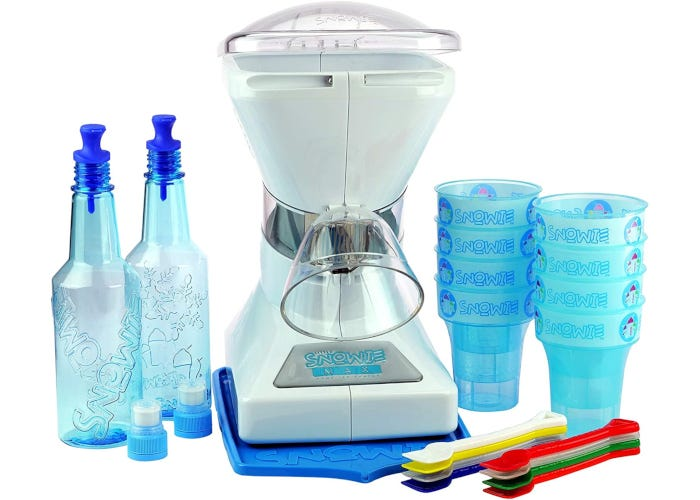 White heavy-duty snow cone machine kit with blue serving cups, two syrup bottles, and colorful spoons.