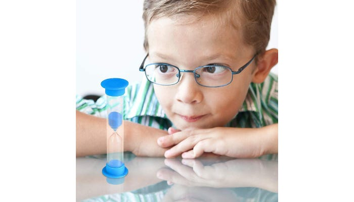 Little boy watching sand in sand timer