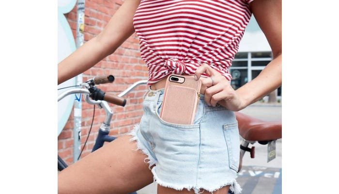 a girl putting her iPhone in her pocket before she rides away on her bike.