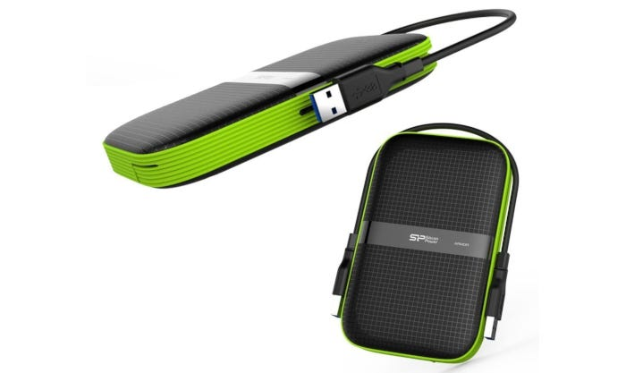 Black external HDD with green side detail and grid design on face pictured with USB 3.0 cable