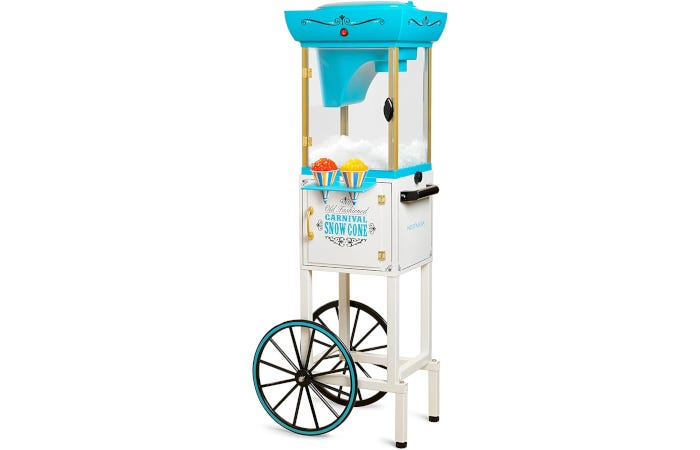 Vintage carnival-style snow cone machine with two large wheels, snow cone holders, and glass windows.