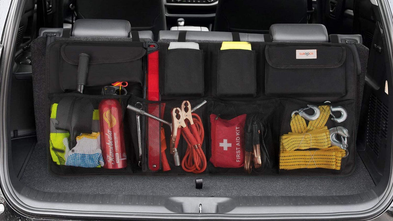 A hanging trunk storage organizer with pockets full of emergency supplies and tools.