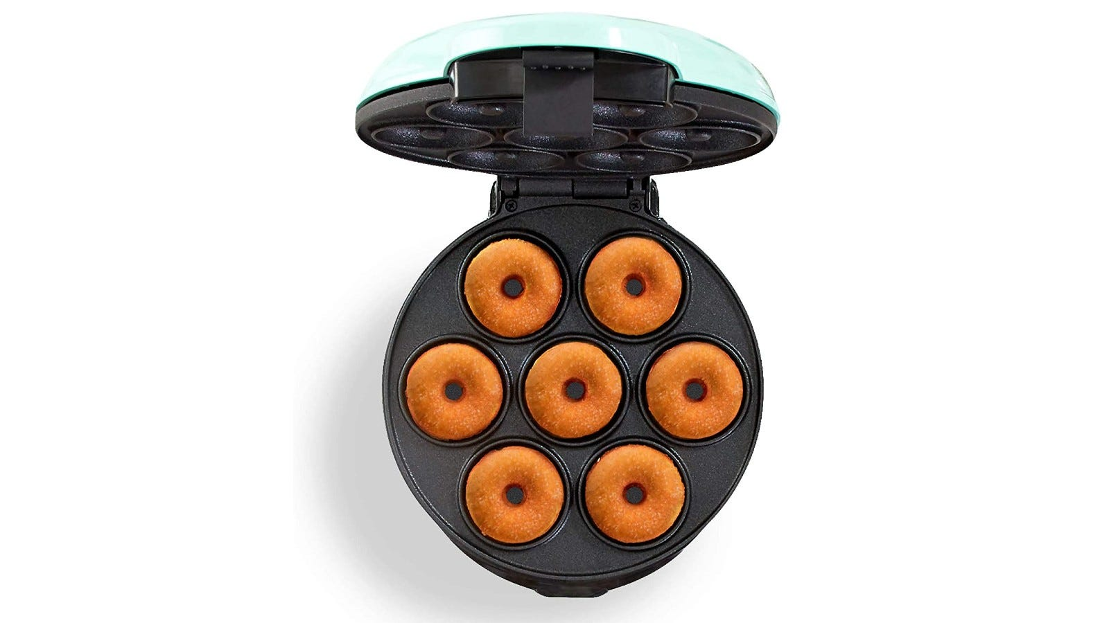 an open donut maker with seven golden donuts inside the grooves