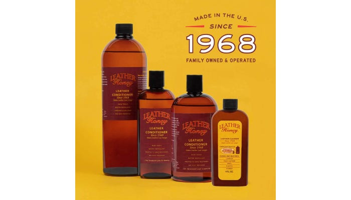 Four bottles of leather conditioner on a yellow background.