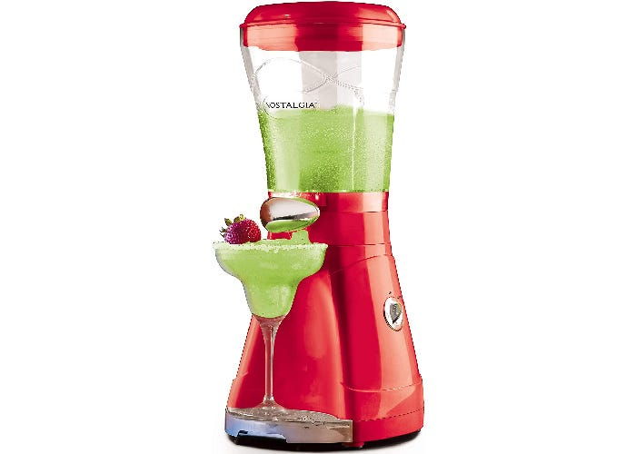 red margarita machine with a filled glass in front