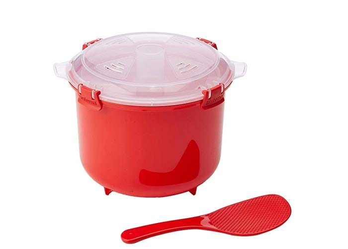 red plastic container with clear plastic lid and a rice paddle