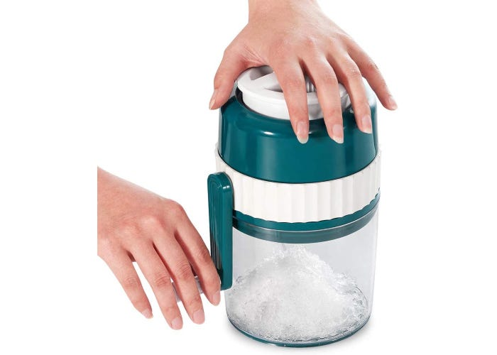 A person using a portable manual hand crank ice shaver.