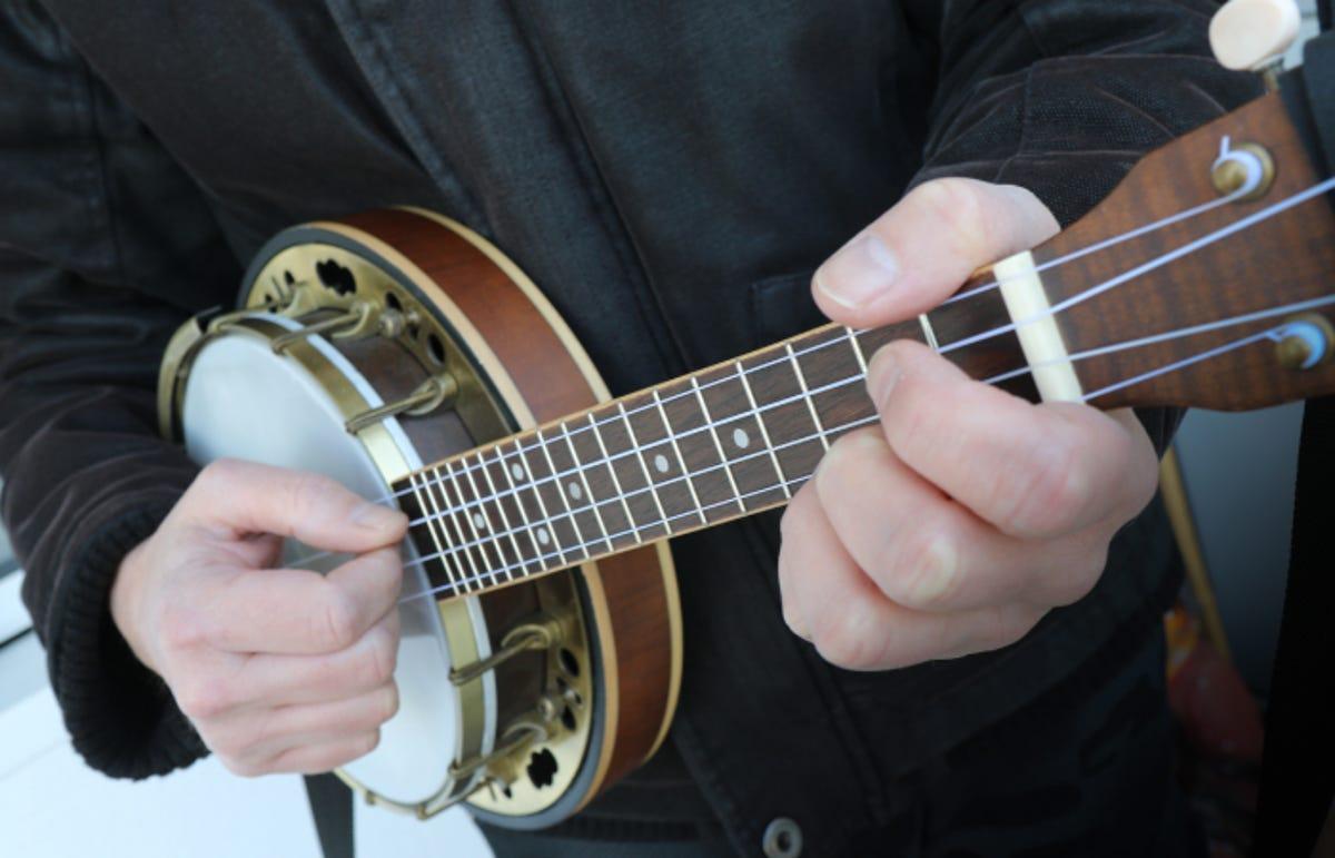 man playing a banjolele