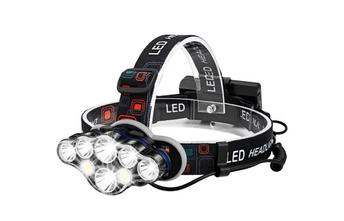 headlamp with a strap around head and above head and multiple bulbs