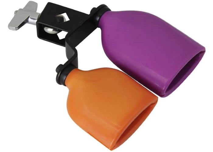 An attached purple and orange cowbell for a drum set.