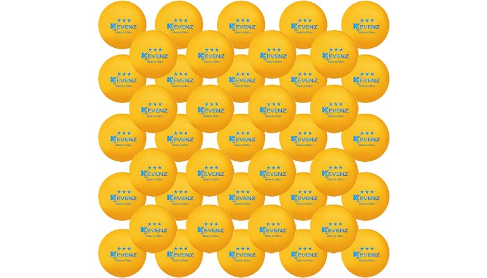 A group of 60 yellow ping pong balls with blue lettering that are evenly aligned.