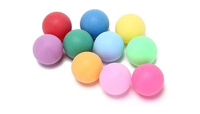 A group of colorful ping pong balls.