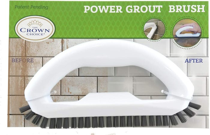 White grout brush with large handle, narrow design, and strong, rigid bristles