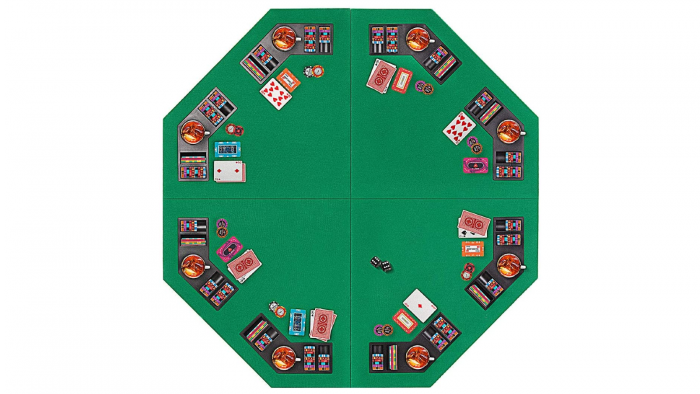 A top view of a green poker table top that has a octagonal shape.