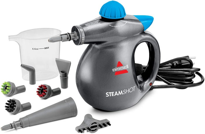 Gray steam cleaner with various attachments including a grout-cleaning attachment