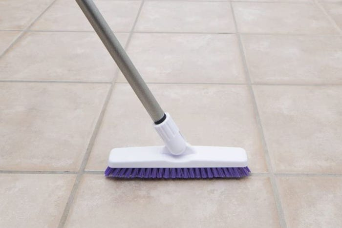 Grout brush with long telescopic handle and tough, firm bristles