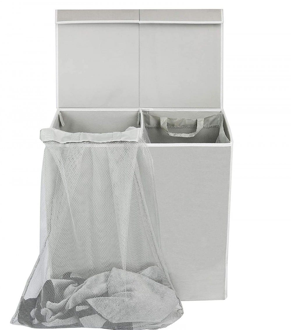 Gray laundry hamper, divided in two sides, with a mesh bag hanging out