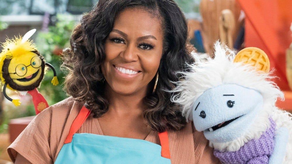 """Michelle Obama két bábbal """"Gofri + Mochi."""""""