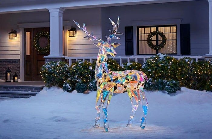 A six foot tall light-up reindeer glows with iridescent panels.