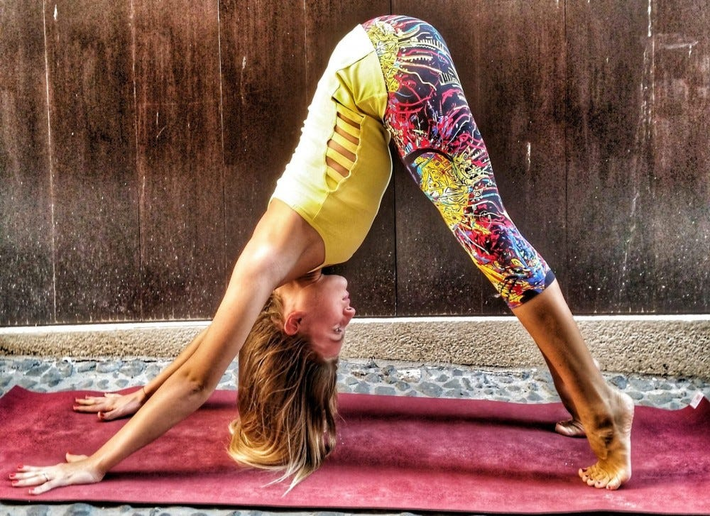 A woman doing a downward-facing dog yoga pose.