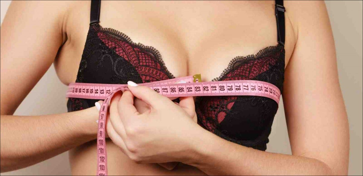 Woman black bra measuring bust size