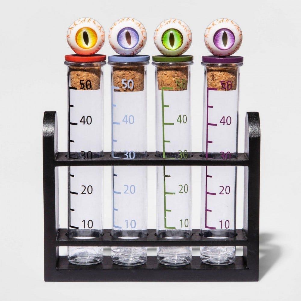 Four test-tube shot glasses in a rack.