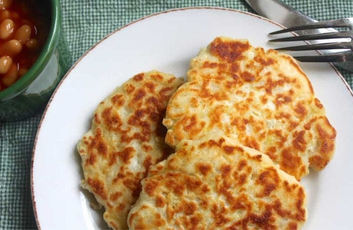 A plate with three freshly cooked Irish potato pancakes called boxty.