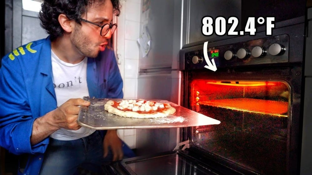 Alex inserting a pizza into his modified oven.