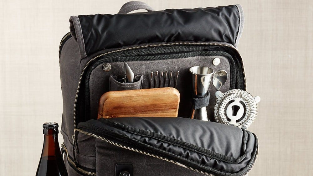 The Crate and Barrel Outfitted Bar Backpack with some accessories peaking out.