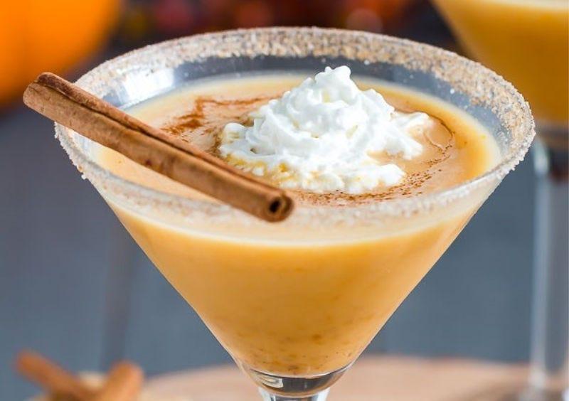 A Pumpkin Pie Martini with whipped cream and a sugared rim.