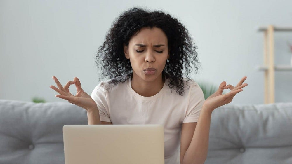Women having trouble doing traditional breathing exercises, forehead scrunched in frustration.