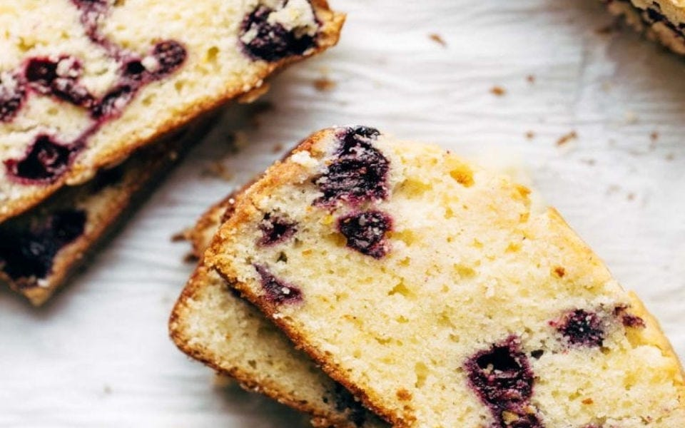 Four slices of blueberry lemon bread.