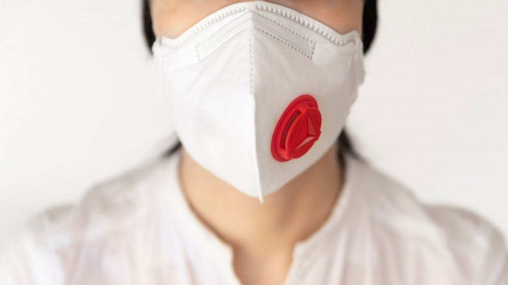 Woman wearing an N95 filtration mask with a valve.