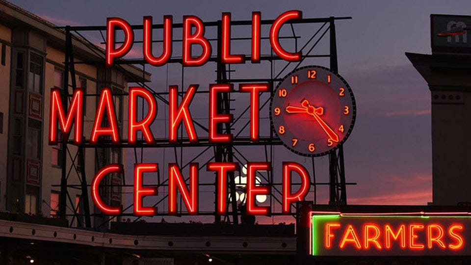 The large neon sign outside the Pike Place Market in Seattle