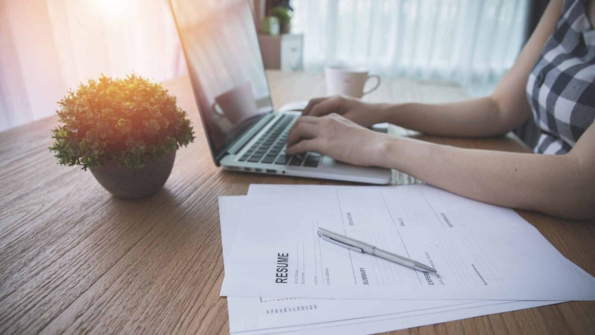 Woman working on her resume in a sunny room