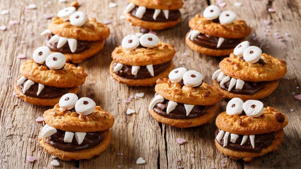 Cookies sandwiched together with chocolate and decorated to look like little monsters.