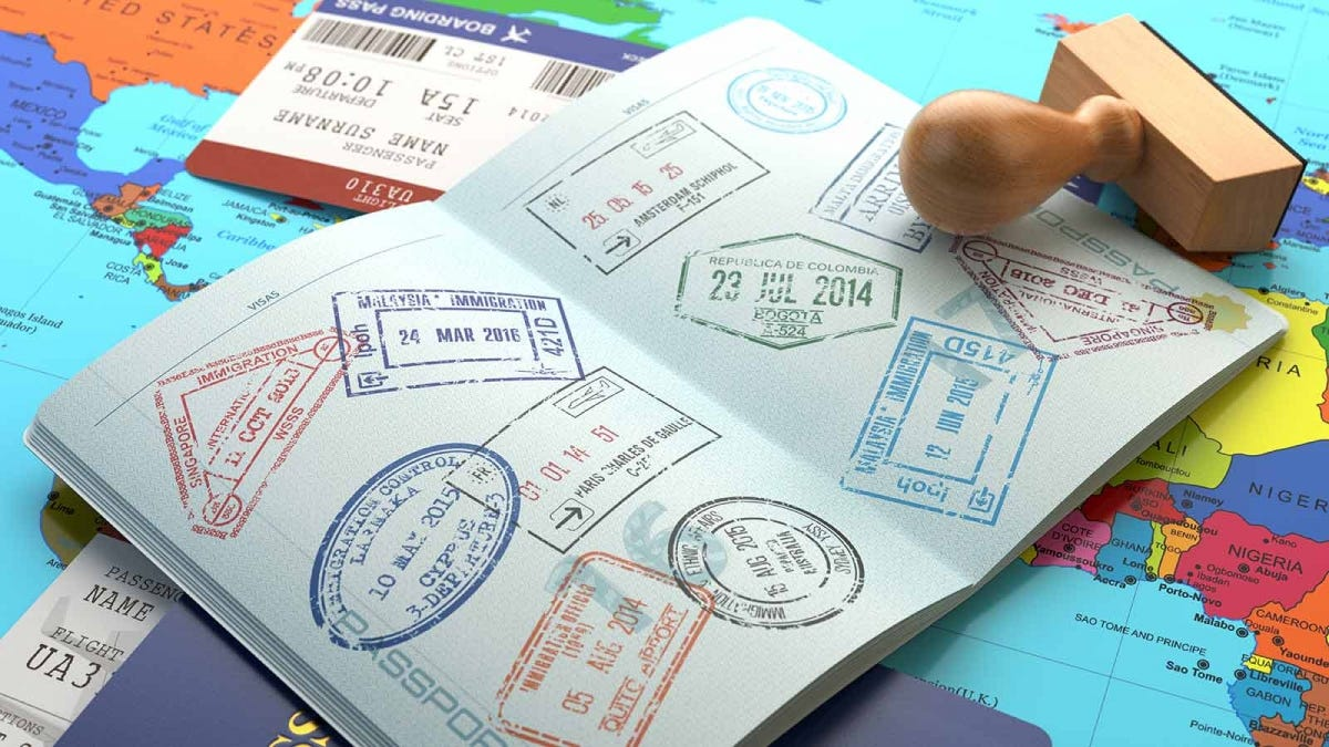 A passport, covered in visa stamps