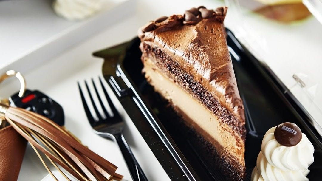 A slice of chocolate cheesecake on a plate.
