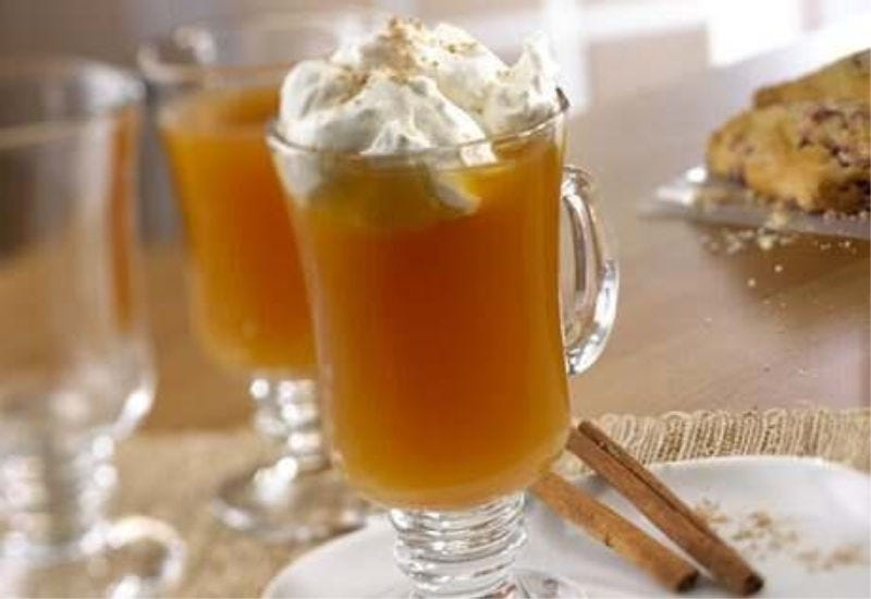 Two glass mugs filled with hot spiced apple cider