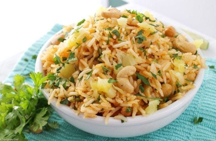 A small bowl filled with coconut pineapple fried rice.