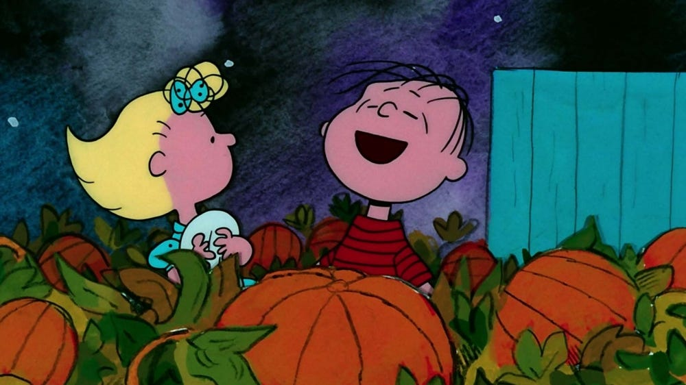 "Sally and Linus in the pumpkin patch in a scene from ""It's the Great Pumpkin, Charlie Brown."""